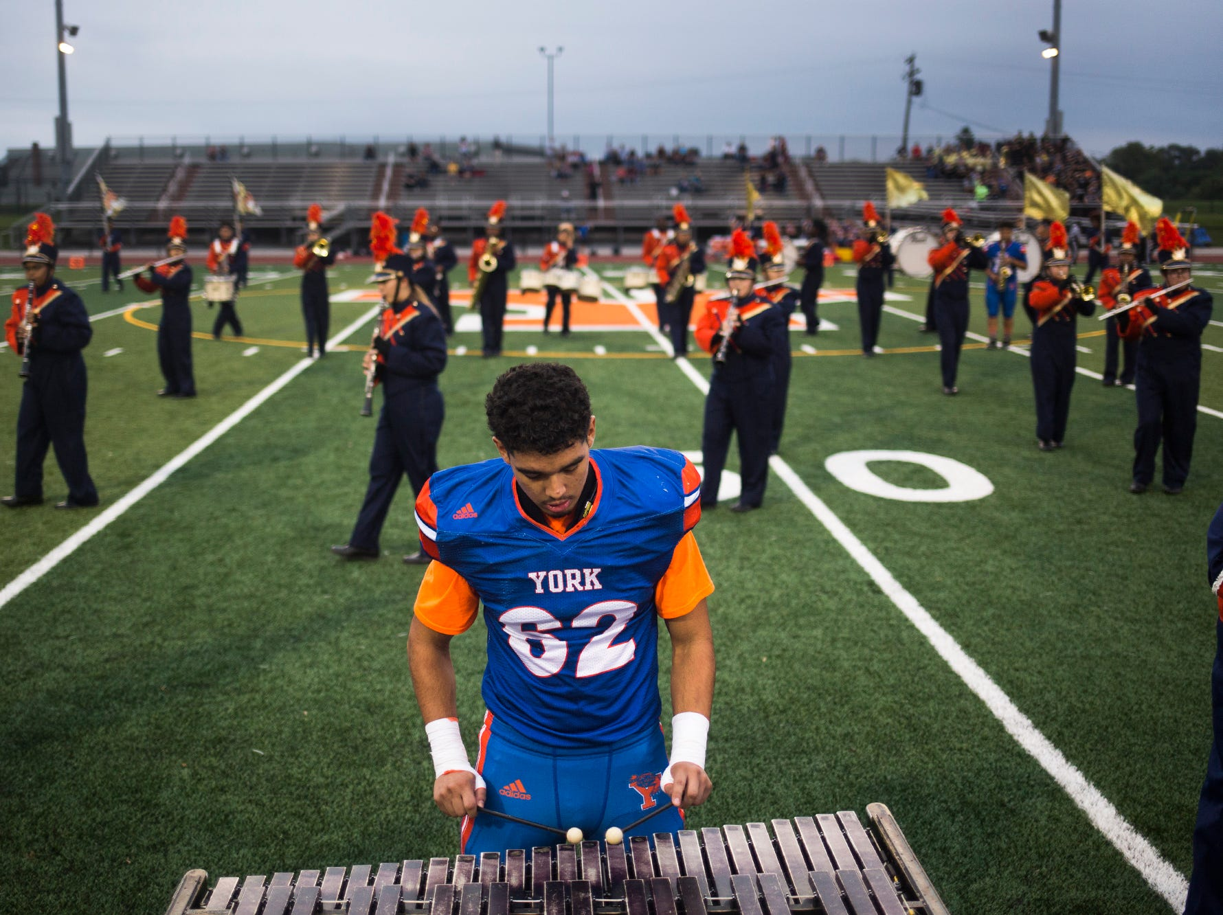 The York High High School marching band, including Bearcats player William Molina, performs prior to the game. York High defeats New Oxford 71-14 in football at Small Athletic Field in York, Friday, September 14, 2018.