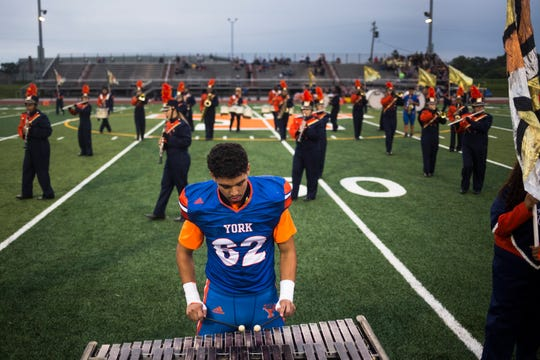 The York High marching band, including Bearcats player William Molina, performs prior to the game Sept. 14, 2018. York High defeated New Oxford, 71-14, at Small Athletic Field.
