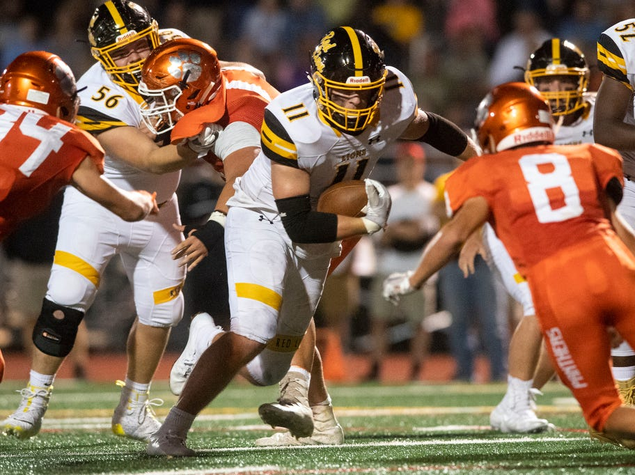 Red Lion's Elijah Workinger (11) runs the ball up the field during a game at Central York on Friday, September 14, 2018. The Red Lion Lions beat the Central York Panthers, 42-21.