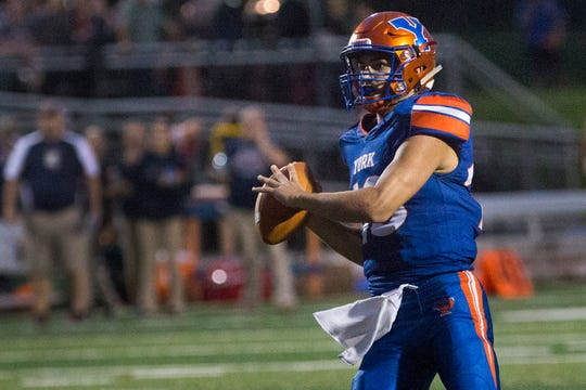 York High quarterback Seth Bernstein looks to pass the ball. York High defeats New Oxford 71-14 in football at Small Athletic Field in York, Friday, September 14, 2018.