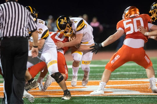 Red Lion's Tyler Ness (4) runs the ball up the middle during a game at Central York on Friday, September 14, 2018. The Red Lion Lions beat the Central York Panthers, 56-28.