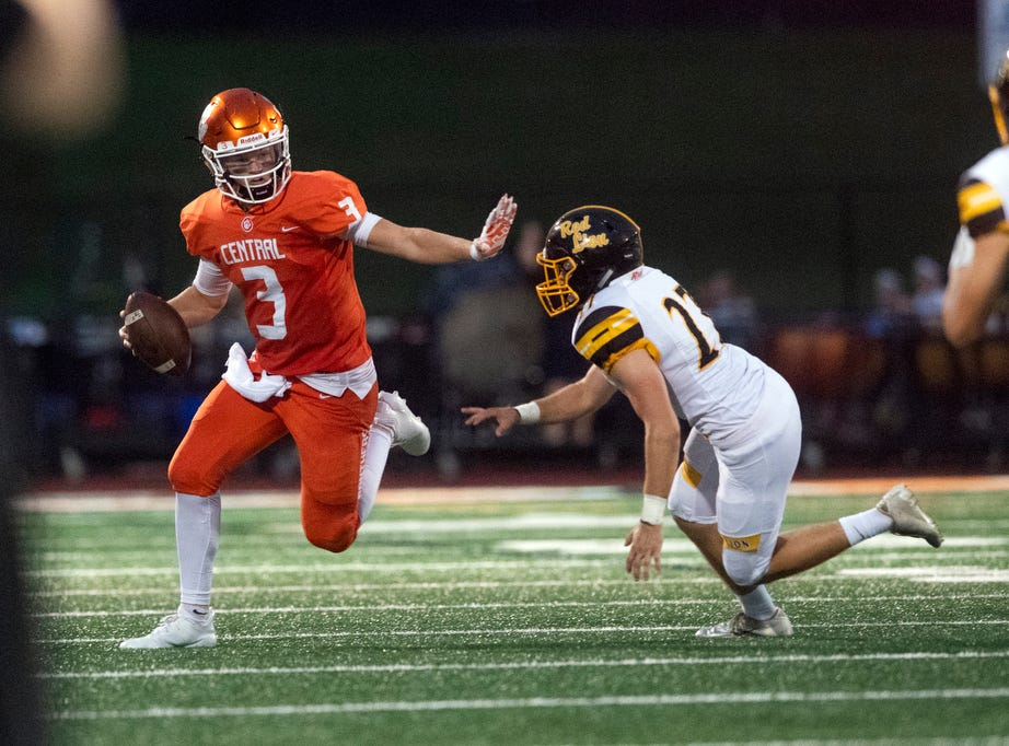 Central York quarterback Cade Pribula (3) runs the ball against Red Lion's Justin Dillion (27) during a game at Central York on Friday, September 14, 2018. The Red Lion Lions beat the Central York Panthers, 56-28.