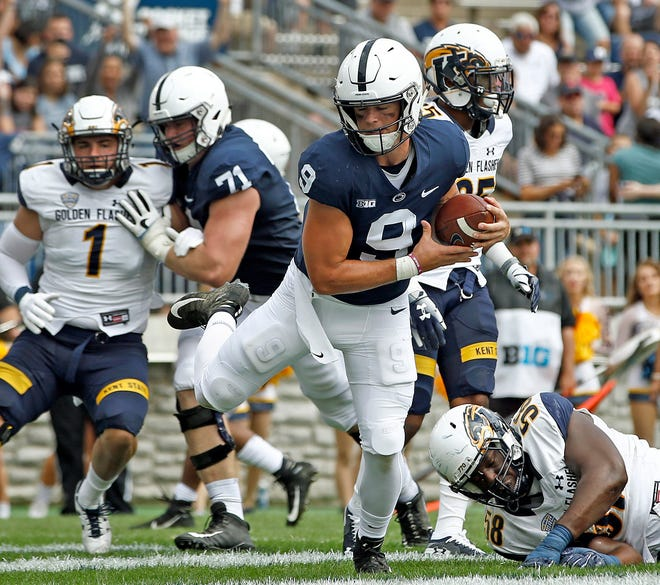 Penn State quarterback Trace McSorley (9) runs in for a touchdown against Kent State during the first half of an NCAA college football game in State College, Saturday, Sept. 15, 2018. (AP Photo/Chris Knight)