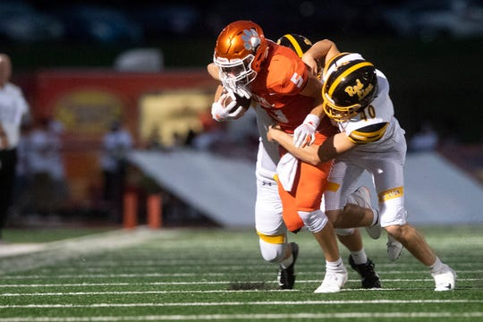 Red Lion's Kurt Keough (40) tackles Central York's Beau Pribula (5) during a game at Central York on Friday, September 14, 2018. The Red Lion Lions beat the Central York Panthers, 56-28.