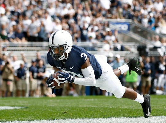 Penn State's DeAndre Thompkins (3) catches a touchdown pass against Kent State during the first half of an NCAA college football game in State College, Saturday, Sept. 15, 2018. (AP Photo/Chris Knight)