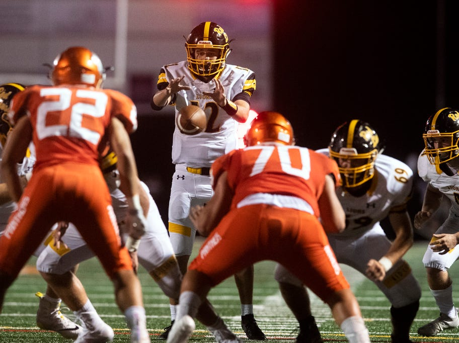 Red Lion quarterback Zach Mentzer (12) snaps the ball during a game at Central York on Friday, September 14, 2018. The Red Lion Lions beat the Central York Panthers, 42-21.