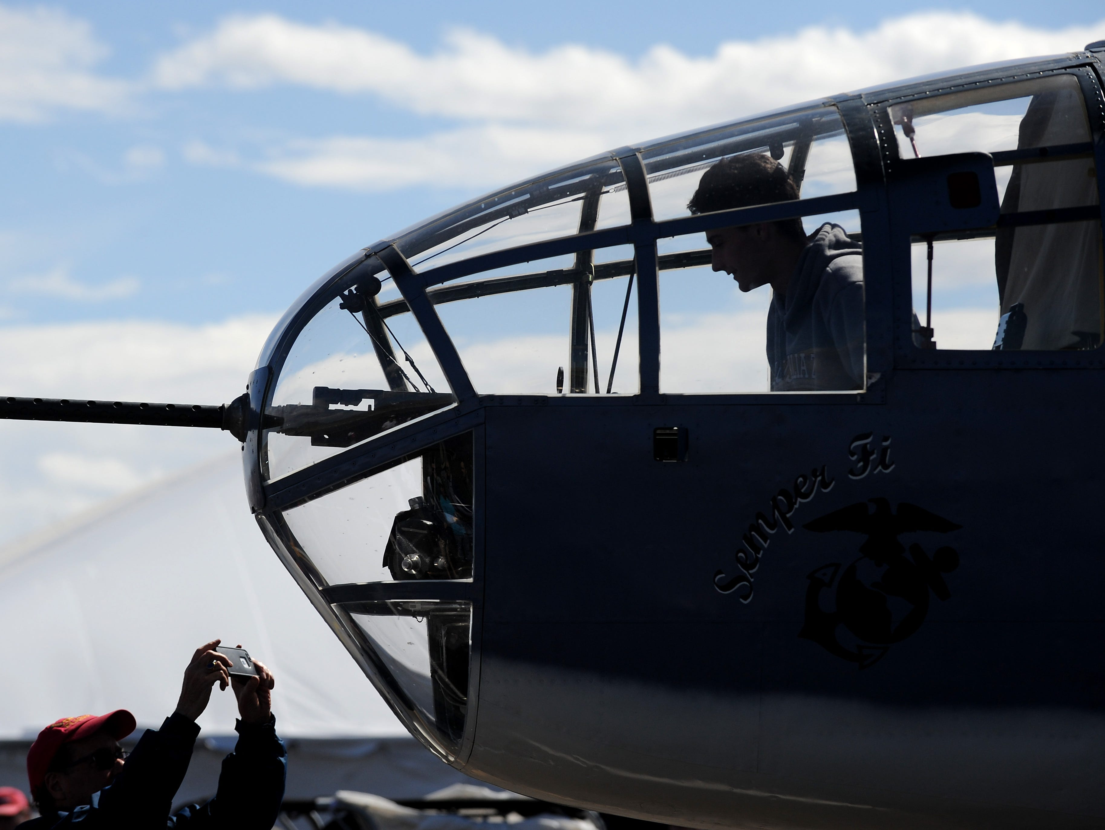 A lucky spectator gets his photo taken in the front gunner position in a PBJ B-25 Marine Bomber at the STIHL National Championship Air Races at Stead Airport north of Reno on Sept. 15, 2018.