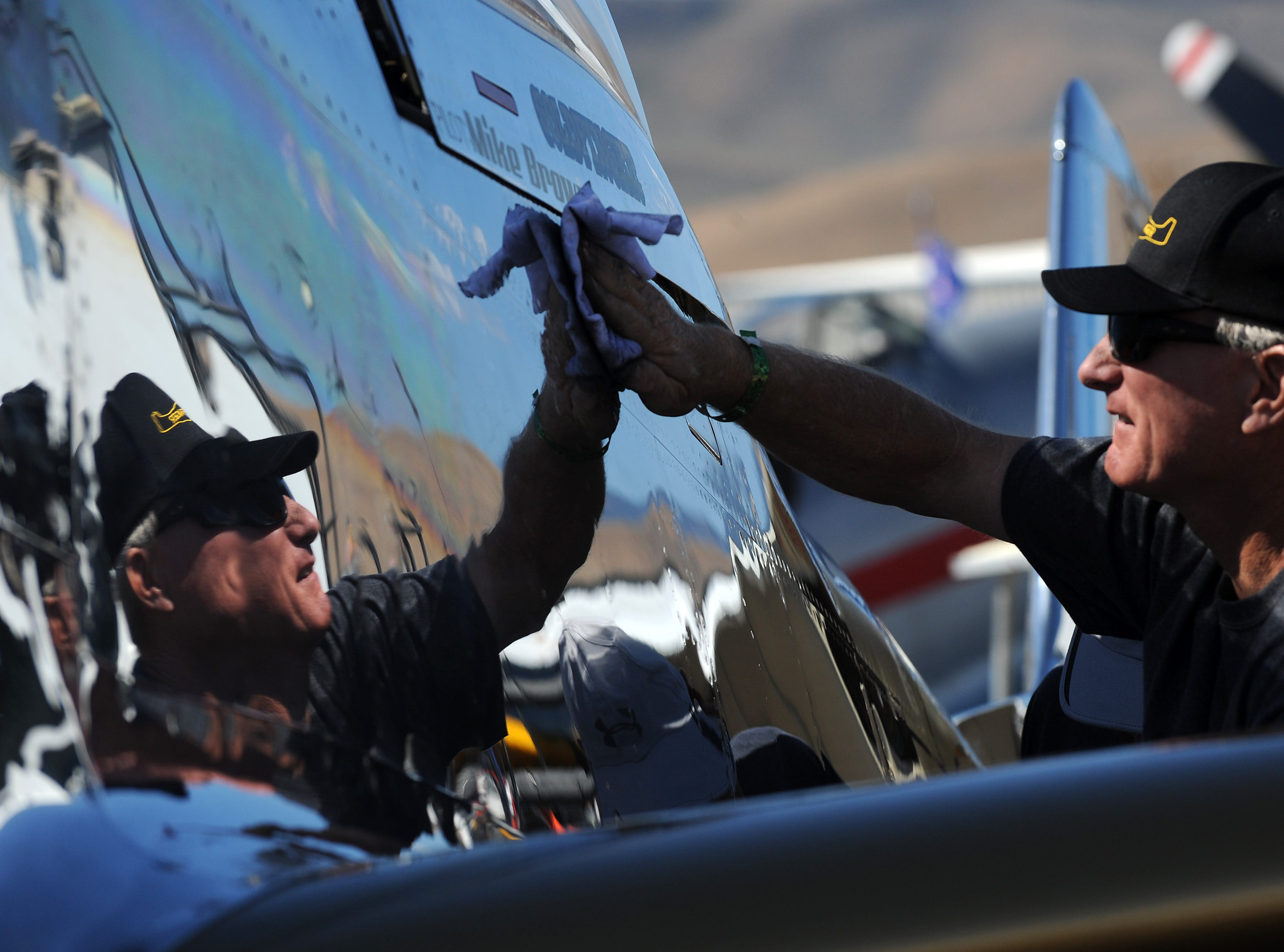 A crew member puts mirror polish on a plane during the STIHL National Championship Air Races at Stead Airport north of Reno on Sept. 15, 2018.