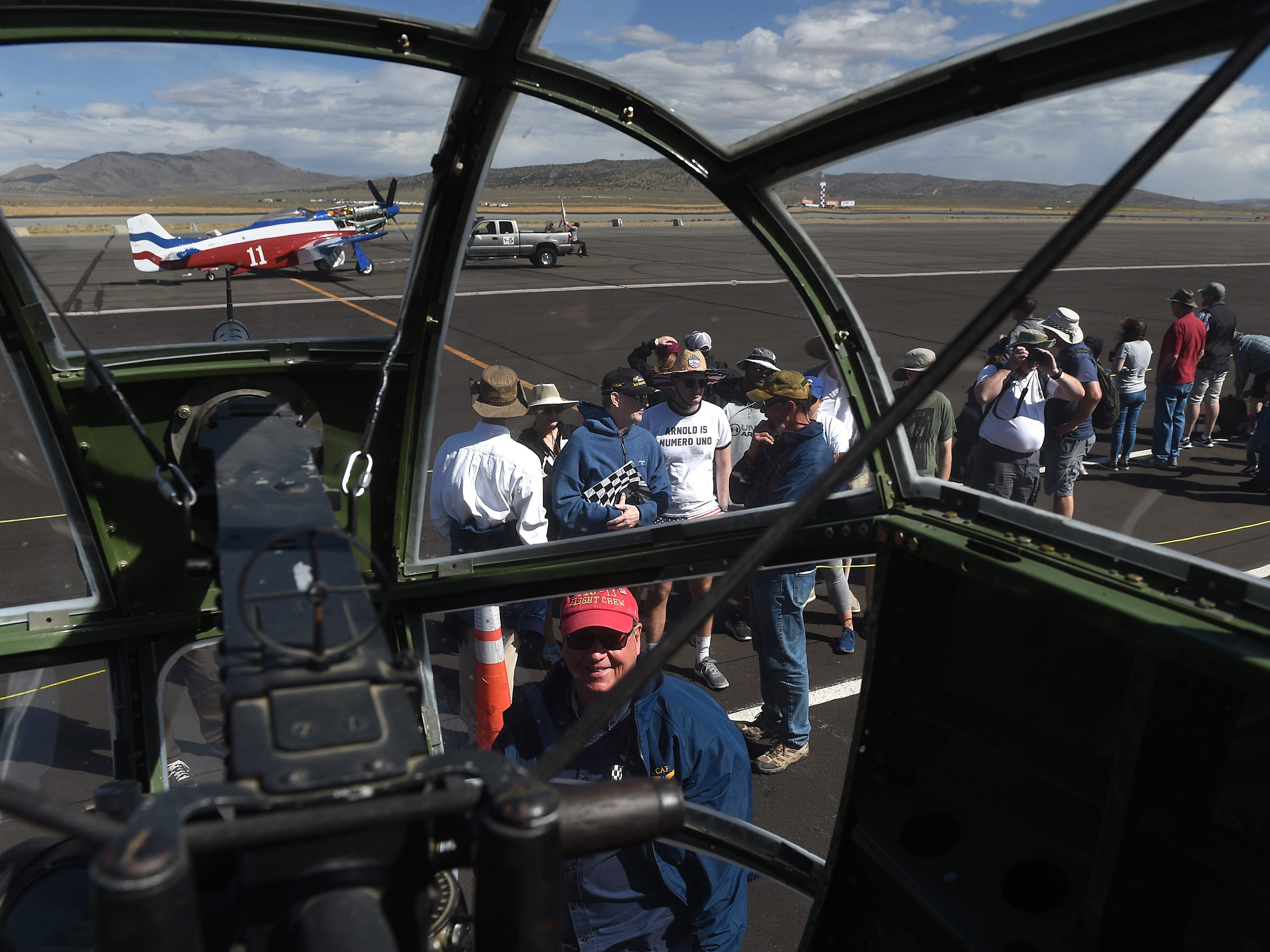 Race fans and are seen from the vantage point of the front gunner position in a PBJ B-25 Marine Bomber at the STIHL National Championship Air Races at Stead Airport north of Reno on Sept. 15, 2018.