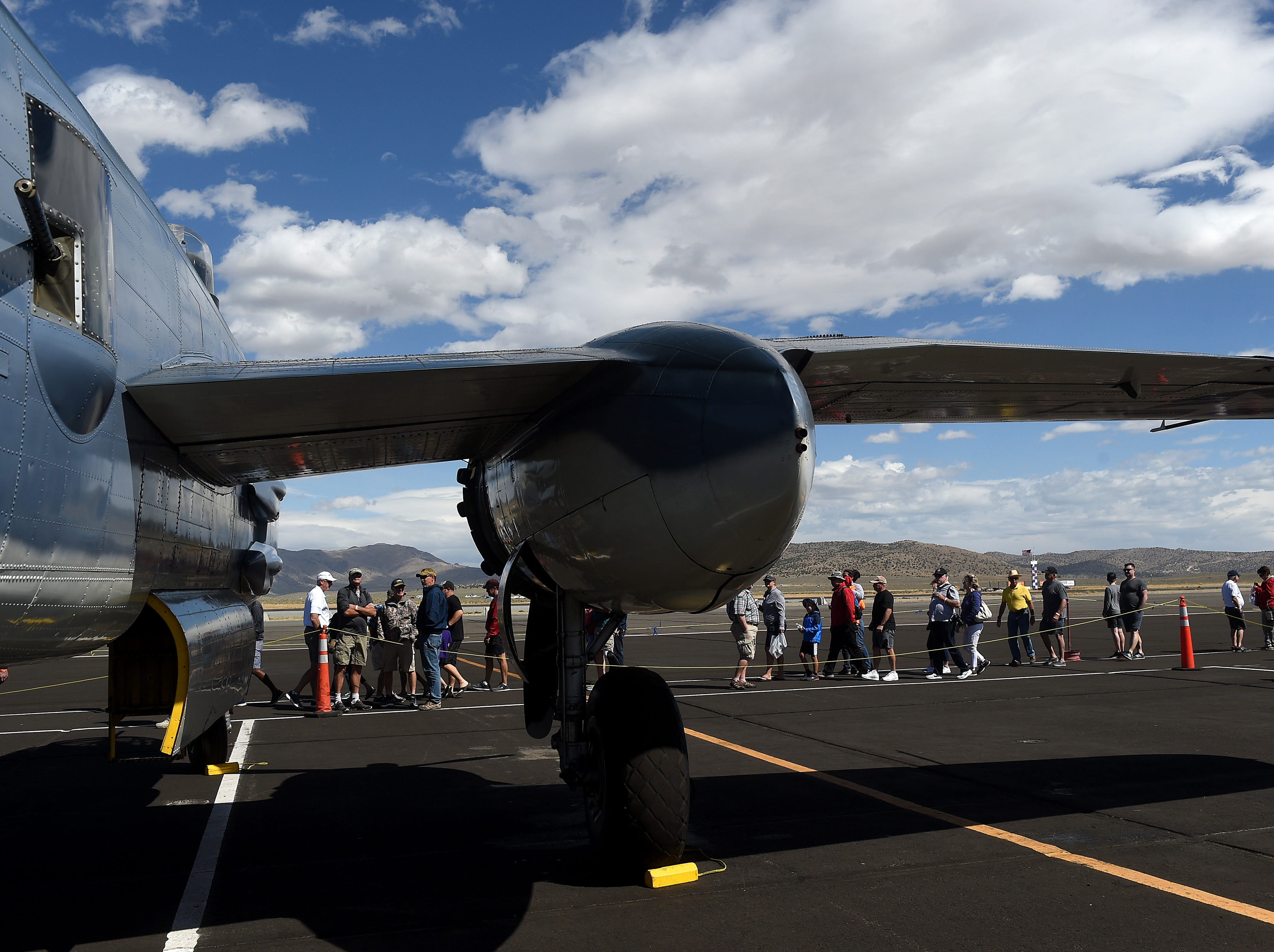 Race fans and are seen walking past a PBJ B-25 Marine Bomber at the STIHL National Championship Air Races at Stead Airport north of Reno on Sept. 15, 2018.