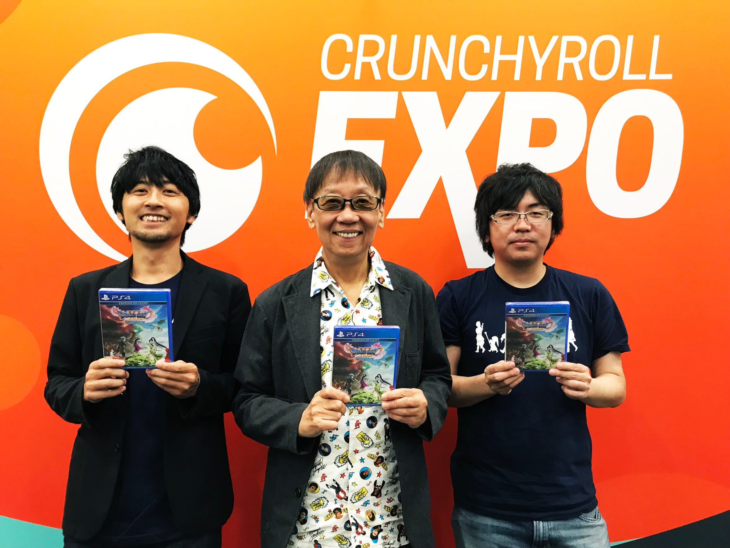 Dragon Quest XI director Takeshi Uchikawa (from left), series creator Yuji Horii and producer Hokuto Okamoto pose with copies of the game after an interview at Crunchyroll Expo 2018 on Sept. 3, 2018 in San Jose, Calif.