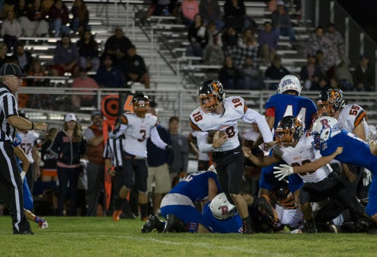 Douglas quarterback Colton Weidner breaks through the Reno line and runs for a 43 yard touchdown in their football game at Reno High School on Friday night, Sept. 14, 2018.