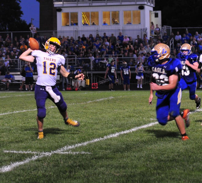 Hagerstown's Noah Snodgrass (12) prepares to make a pass during a football game against Lincoln in Cambridge City Friday, Sept. 14, 2018.