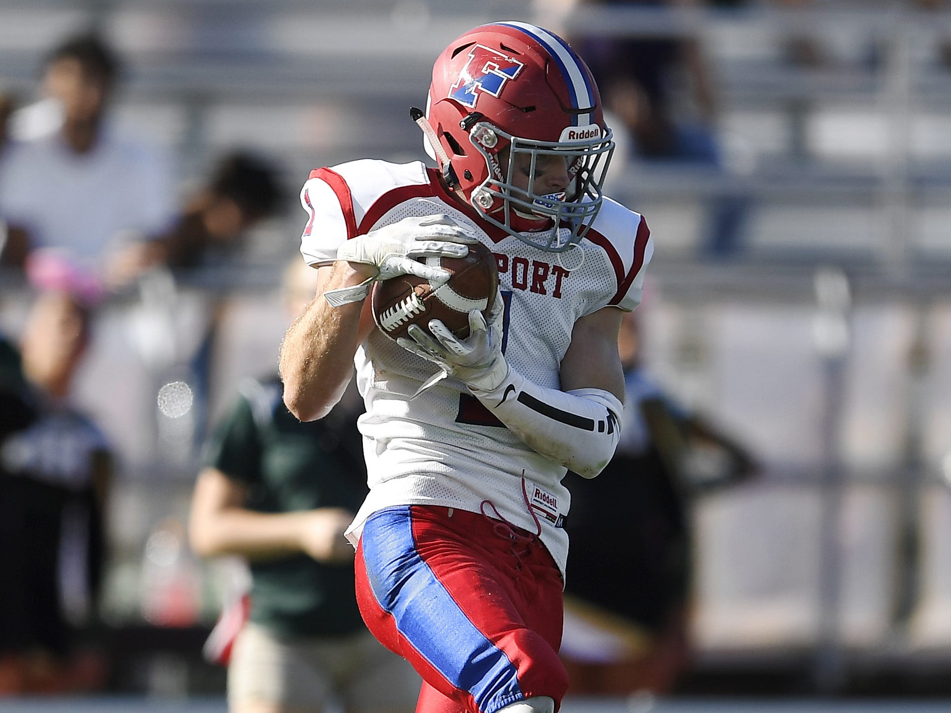 Fairport's Gavin Carlson intercepts a pass late in the game at Rush-Henrietta High School on Saturday, Sept. 15, 2018.