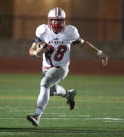 Canandaigua's Zachary Wantuck gains yards against Eastridge.