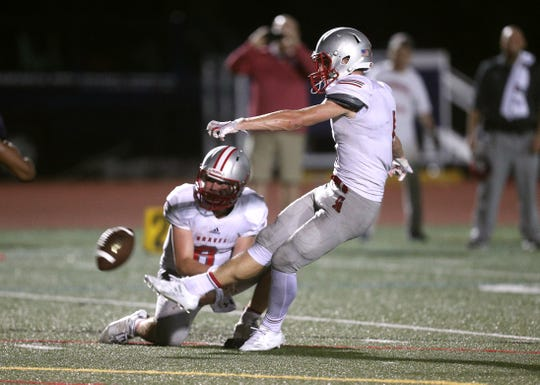 Canandaigua's Matt Vierhile kicks the go ahead field goal in a 31-21 win  over Eastridge.