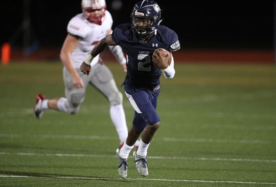 Eastridge's Sher'Ron Davis looks for yards.