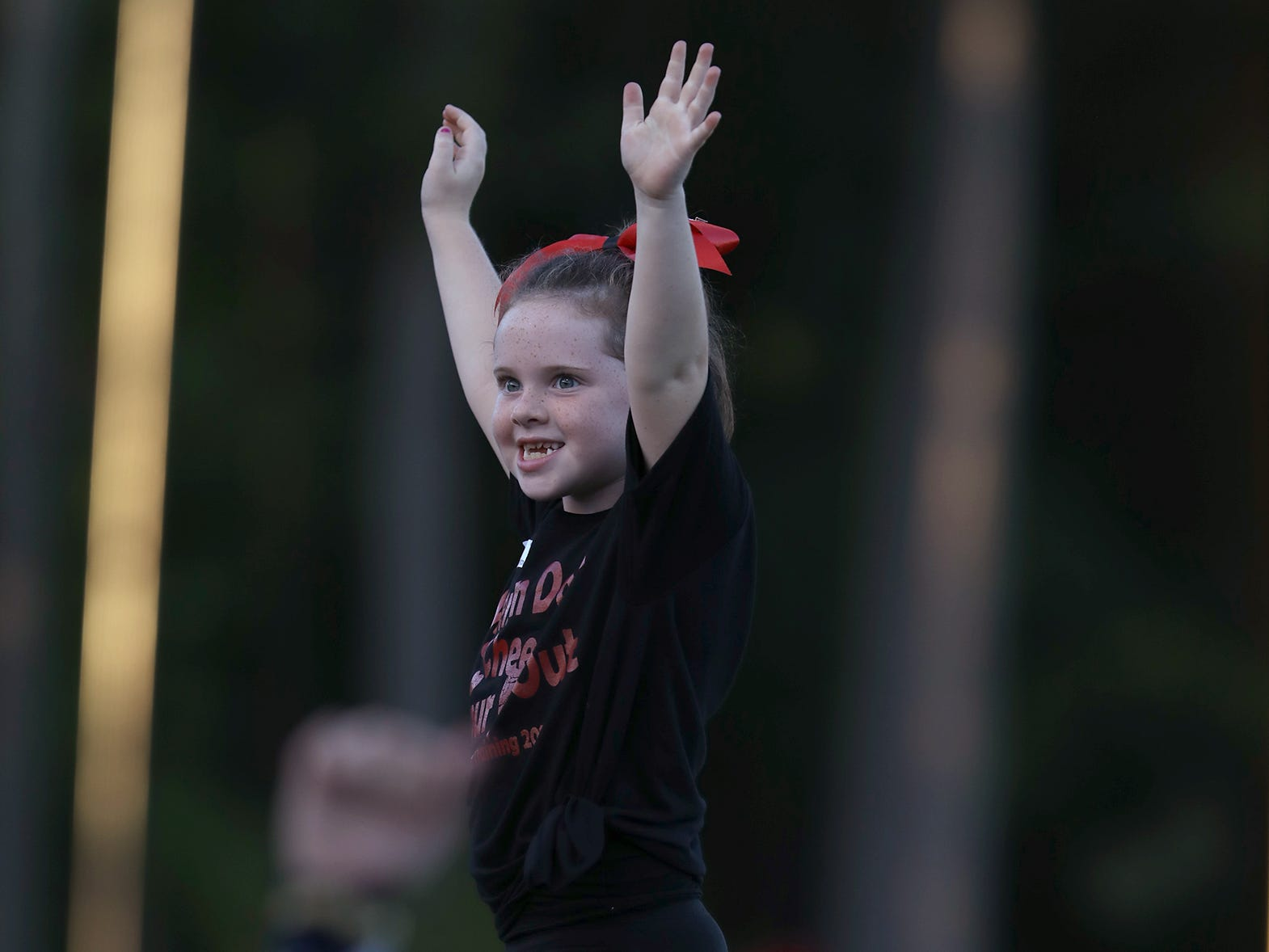 Payton Lauber, a 7-year-old Titan in Training, cheered with the rest of the Titan in Training squad and the high school cheerleaders before and during the first half of Webster Thomas's home game.