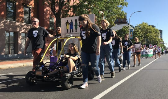 Members of Art Force 5 march with their go-kart in the Suffragist City Parade Sept. 15. The parade went along West Main Street to Madison Street and finished at Susan B. Anthony Square Park.