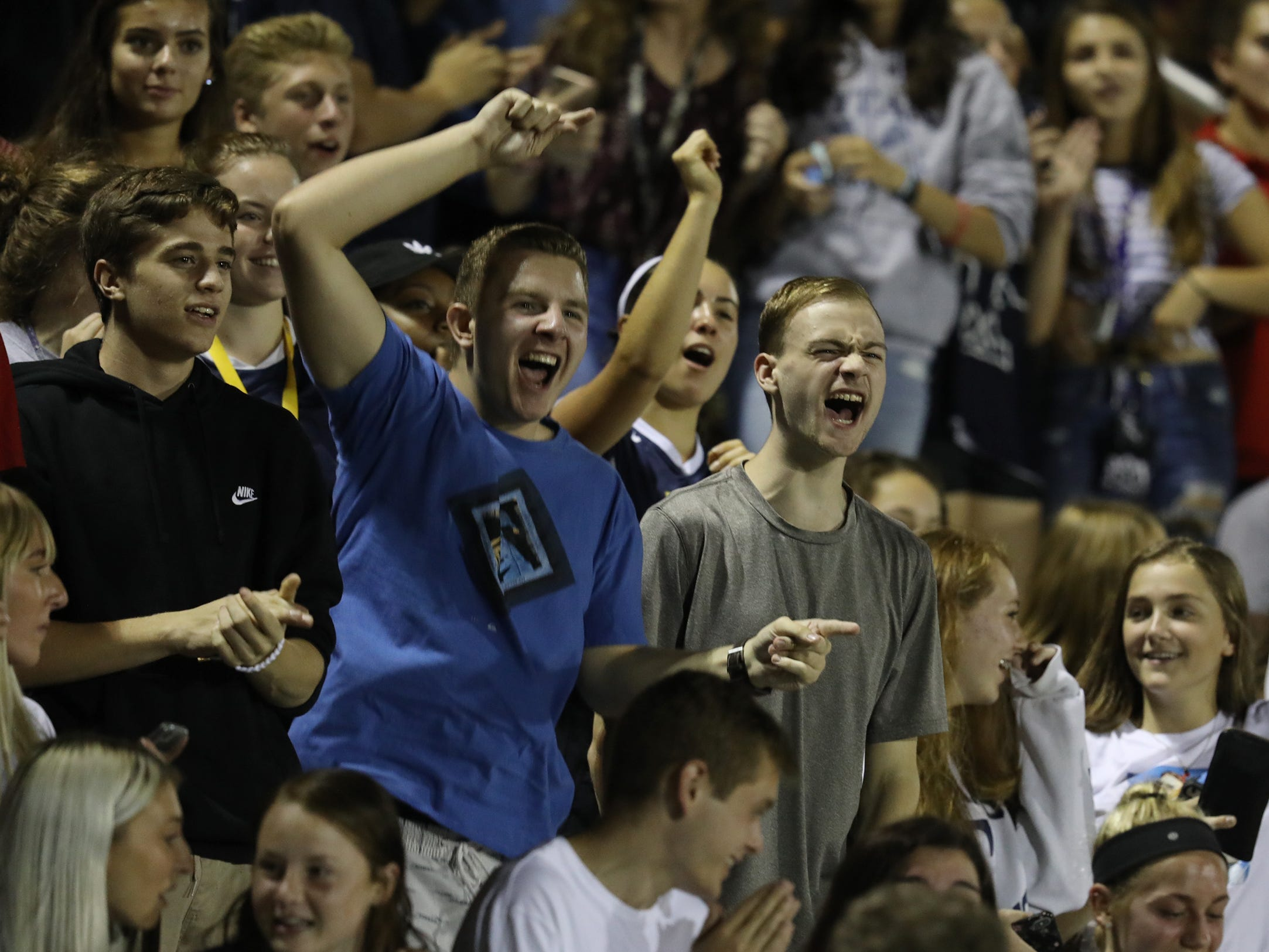 Webster Thomas student section errupts in cheers as their team scores.