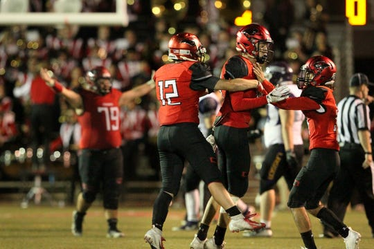 Foothill players celebrate after they won over Lassen, 31 - 28, at home on Friday, Sept. 14.