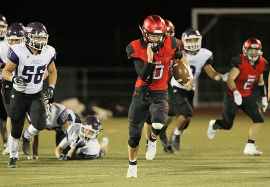 Foothill's QB, Jayden Gordon (10) heads for the end zone to score a touchdown against Lassen at the start of the third quarter on Friday, Sept. 14, 2018. The Cougars defeated the Grizzlies, 31 - 28, at home.
