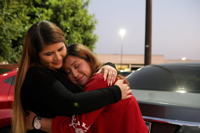 Lizbeth Espinoza Ramirez hugs her mother, Maria Ramirez, in the Northridge Mall parking lot shortly before Ramirez leaves for Mexico. Espinoza Ramirez was unable to take the trip because she needed to work.
