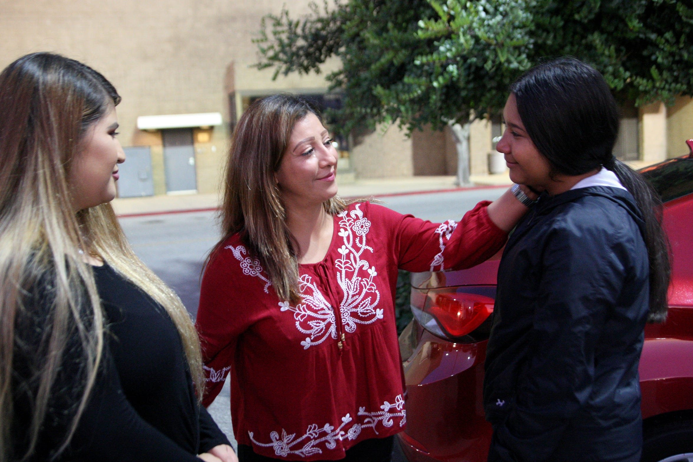 María Ramírez (middle) speaks with her daughters Lizbeth Espinoza Ramírez (left) and Betty Espinoza Ramírez (right) shortly before María and Betty left for a trip to Mexico. Lizbeth was unable to go due to work obligations.