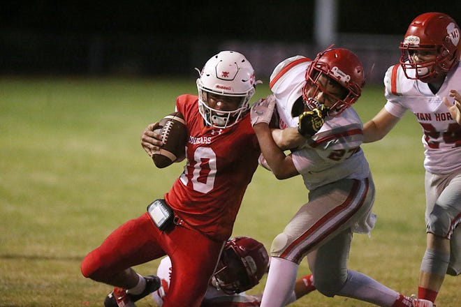 Christoval's Brayden Wilcox (10) is tackled by Van Horn's Jermaine Corralez (27) during their game Friday, Sept. 14, 2018, in Christoval.