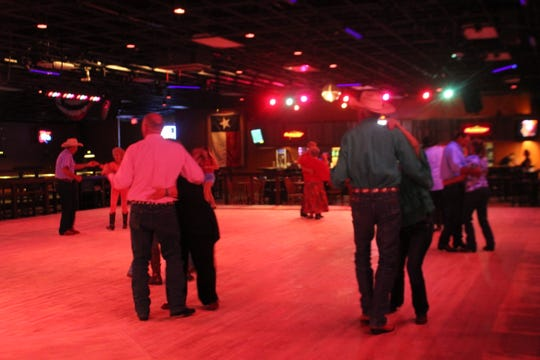 People dancing at the grand opening of The Concho Palace, 2581 Sunset Drive.