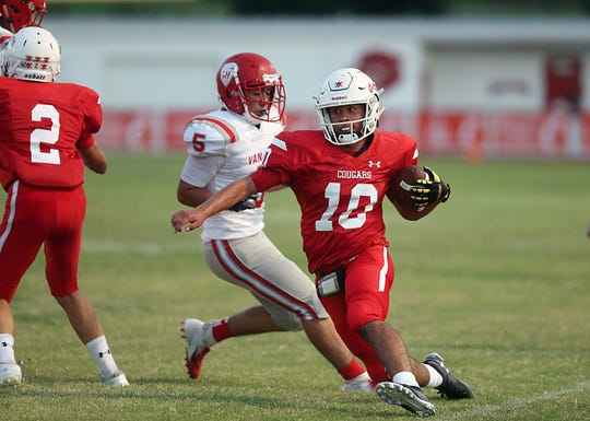 Christoval's Brayden Wilconx (10) tries to outrun Van Horn's Bubba Virdell (5) during their game Friday, Sept. 14, 2018.