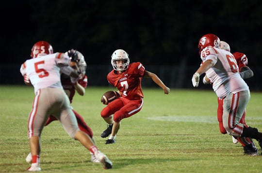 Christoval's David Fava (7) tries to maneuver past Van Horn's defense during their game Friday, Sept. 14, 2018, in Christoval.