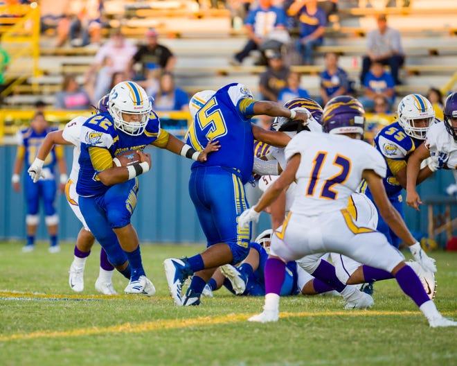 Reagan County's Nathan DeLeon searches for running room during the Owls' 13-6 homecoming win over Ozona on Friday, Sept. 14, 2018.
