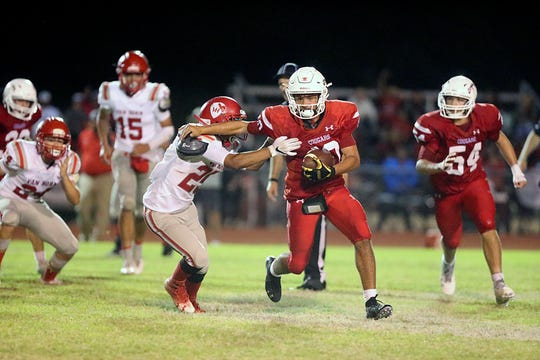 Christoval's Brayden Wilcox (10) pushes past Van Horn's Omar Vasquez (25) during the Cougars' 30-28 win over Van Horn on Friday, Sept. 14, 2018, in Christoval.