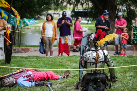 Re-enactors with The Barony of Bonwicke, demonstrate fighting during River Fest Saturday, Sept. 15, 2018, along the Concho River Walk.