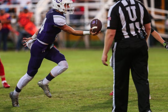 Mason's Otto Wofford looks to pass during the game against Sonora on Friday Sept. 14, 2018, at Mason.