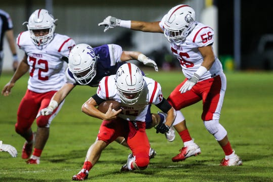 Sonora's Wesley Dutton tries to slide away from Mason defense Friday Sept. 14, 2018, at Mason.