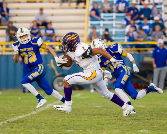 Ozona's Abraham Rodriguez breaks free following a short reception during the Lions' 13-6 loss to Reagan County in Big Lake on Friday, Sept. 14, 2018.