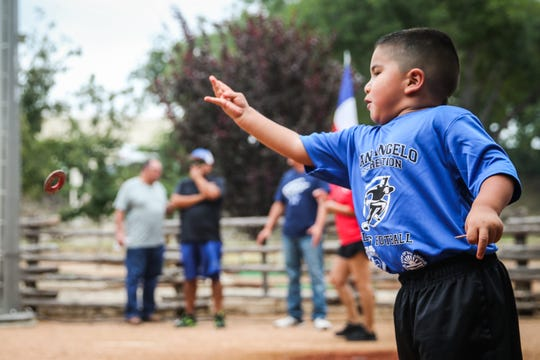 Abraham Ramirez, 5, tosses a washer during River Fest Saturday, Sept. 15, 2018, in the Bosque.