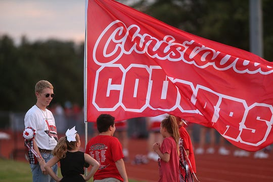 Christoval supporters hold up their team's flag anticipating a touchdown during their game against Van Horn on Friday, Sept. 14, 2018.