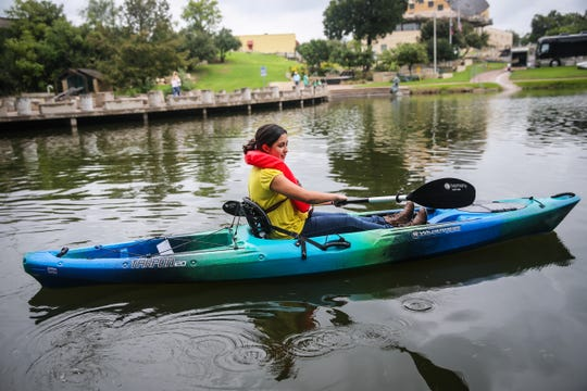 A participant paddles a Happy Trails kayak during River Fest Saturday, Sept. 15, 2018, in the Bosque.
