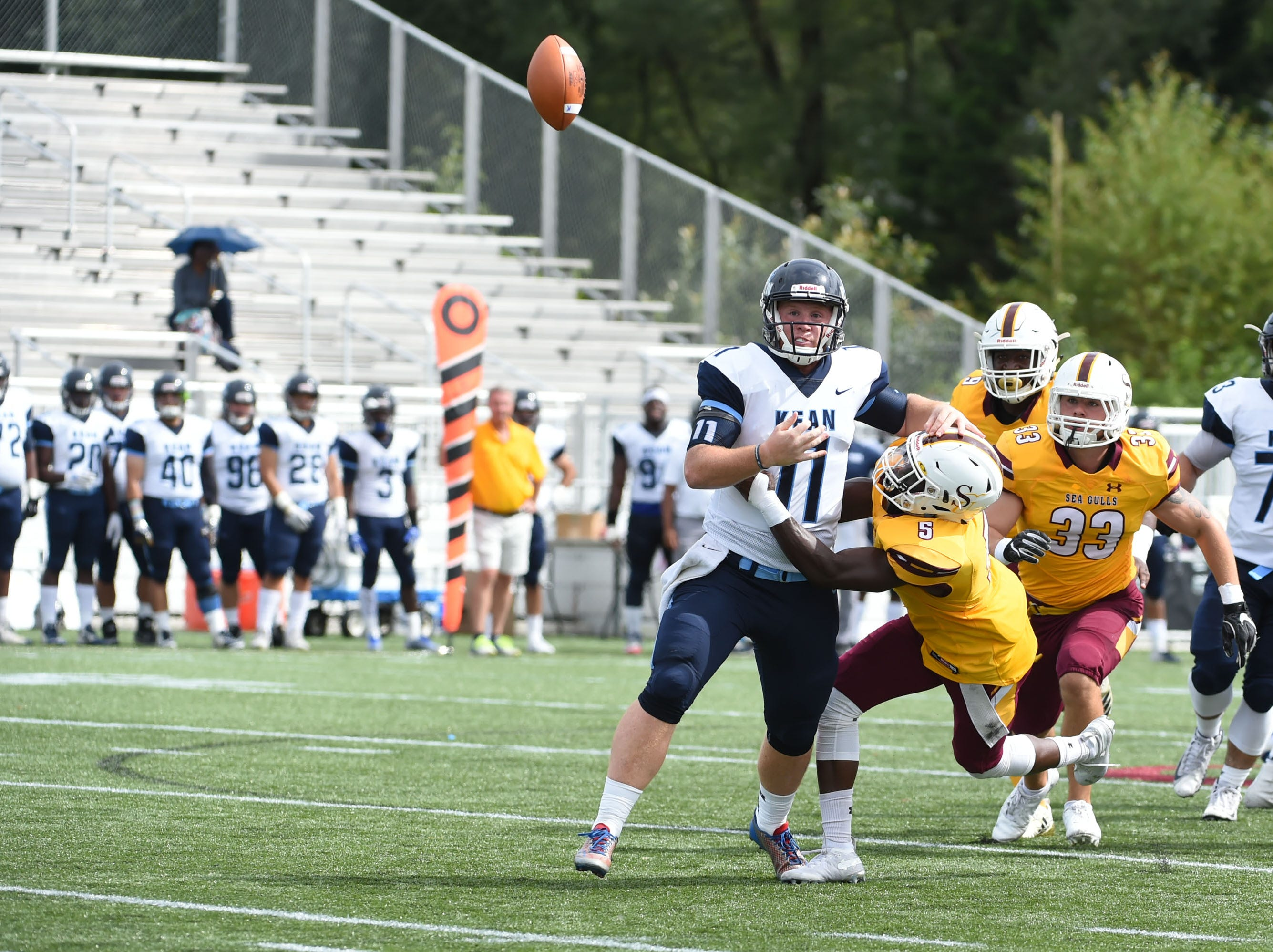 Salisbury's Matthew McFarland knocks the ball out of the hands of the Kean quarter back on Saturday, Sept. 15, 2018 at Seagull Stadium.