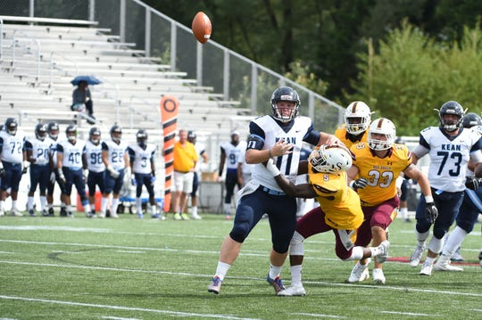 Salisbury's Devinne Greene knocks the ball out of the hands of the Kean quarter back on Saturday, Sept. 15, 2018 at Seagull Stadium.