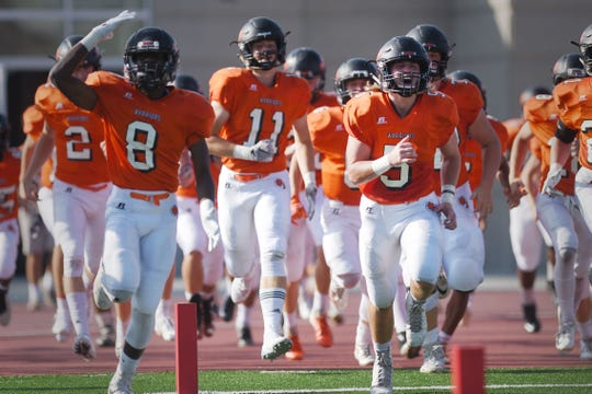 Washington rushes the field for the game against Mitchell Friday, Sept.14, at Howard Wood Field.