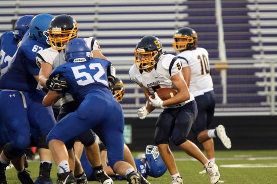 Jaxton Schiller of Sioux Valley cuts into the line during Friday night's game against Sioux Falls Christian at USF Stadium in Sioux Falls.