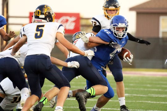 Dawson Mulder of Sioux Falls Christian attempts to elude the tackle by Lane VanderWal of Sioux Valley during Friday night's game in Sioux Falls.
