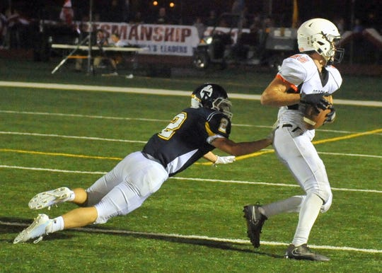 Lennox's Caleb Metcalf sheds a tackle attempt from Tea's Joey Headrick and turns upfield for a 49-yard TD reception on Friday, Sept. 14, in Tea.