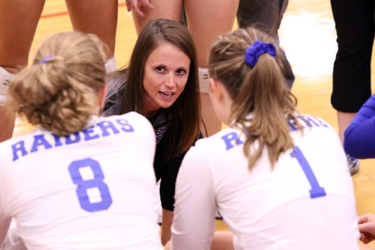 Rapid City Stevens head coach Kylie Voorhees talks with her players during a timeout of Saturday's match with Washington in the Lincoln gym in Sioux Falls.