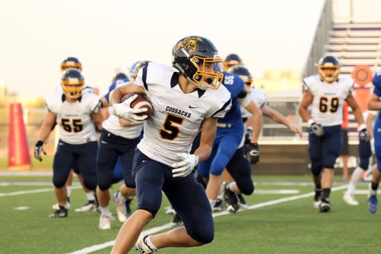 Sioux Valley running back Jaxton Schiller cuts up field during Friday night's game against Sioux Falls Christian at USF Stadium in Sioux Falls.