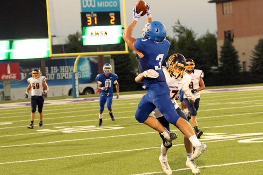 Clay Vinson of Sioux Falls Christian pulls in a pass as Ashton Bultje of Sioux Valley defends during Friday night's game at USF Stadium in Sioux Falls.